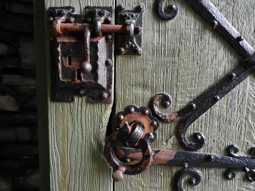 Wrought iron locks, knocker and hinges on a door in Gravensteen Kasteel (Castle) in Ghent, Belgium