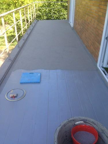 Pose d'une étanchéité de type Technotan sur une terrasse existante, pour la rendre étanche à 100%.