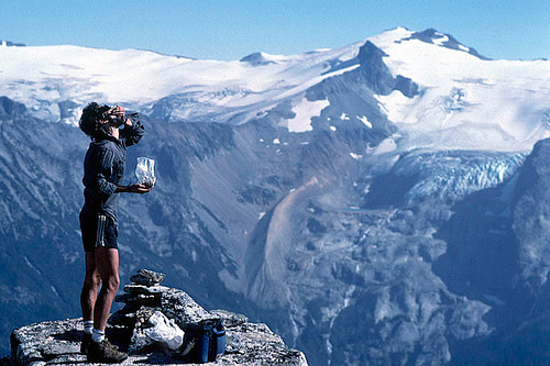 A hiker refuels in Stein Valley Nlaka'pamux Heritage Park, Coast Mountains, Lytton, British Columbia, Canada