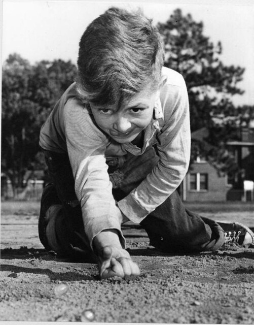 Young boy playing marbles - Jacksonville