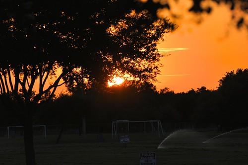 sunset texas orangesky lightshadow sugarland goalposts endoftheday aaaaaah darktrees watersprinklers eldridgepark ahobblingaday