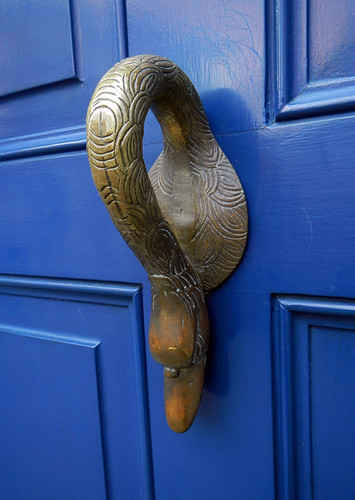Blue Door with Brass Door Handle in the Shape of a Swan
