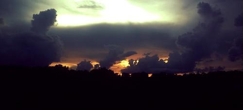 cloudsfluffyskydarksunsetstorm