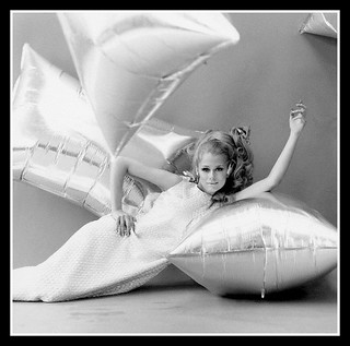 Lauren Hutton  reclines on a large Andy Warhol silver helium-filled pillow wearing a Vogue Pattern 6928 dress, coiffure by Marc Sinclair, photo by Gianni Penati, July 1966 | by skorver1