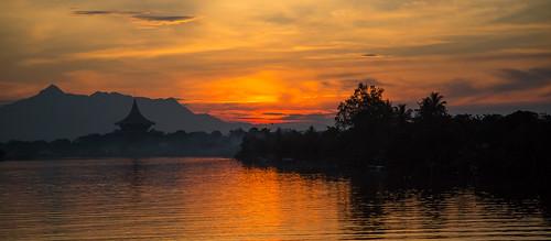 city sunset sky reflection water clouds sarawak malaysia borneo kuching