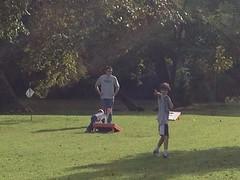 Chris Morden teaching his son the winning strategies of corn hole.