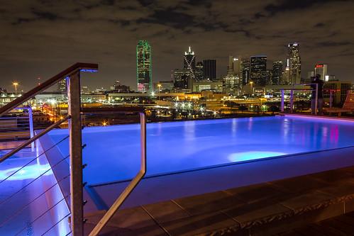 longexposure blue roof urban rooftop pool night clouds buildings hotel dallas downtown neon view swimmingpool nightlife afterdark downtowndallas nylo
