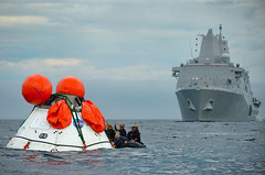 In this file photo, Sailors from USS Anchorage (LPD 23) and Explosive Ordnance Disposal Mobile Unit 11 train during the second underway recovery test for the NASA Orion program in August. (U.S. Navy/MC1 Corey Green)