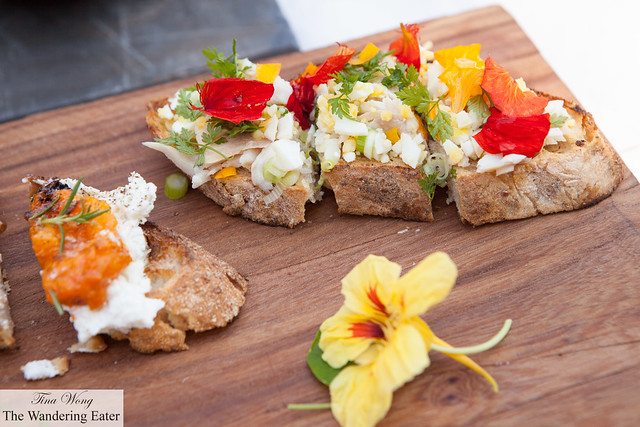 Hot smoked trout and hard boiled egg salad with nasturtiums from her garden bruschetta & wedge of ricotta, roast apricot, rosemary and honey bruschetta