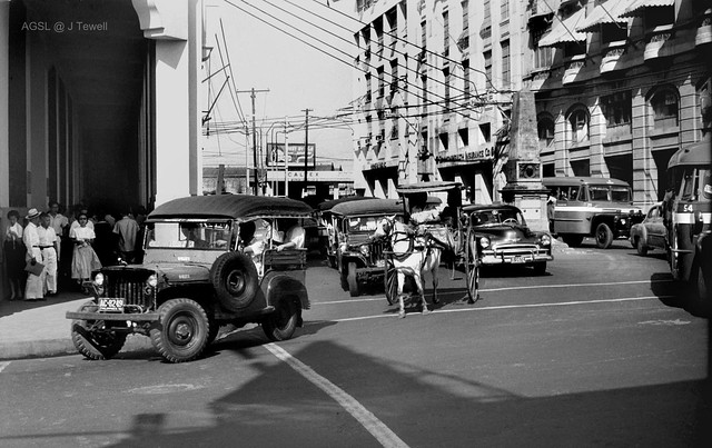 Pedestrian and car traffic on streets of Manila, Philippines, 1950s