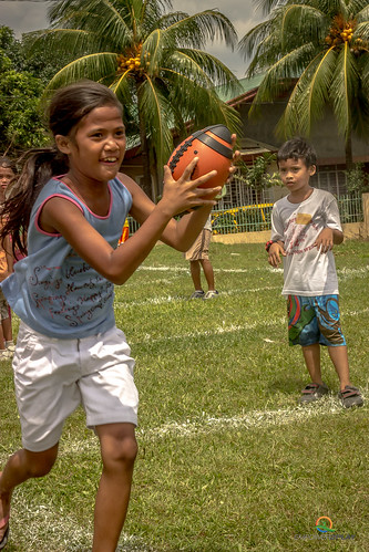 young-girl-running-with-ball-empower-2-play | by empower2play