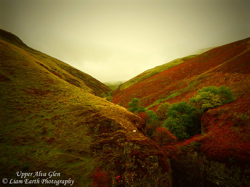 earth scotland alva glen valley landscape scenic green red sky trees bushes grass view ochils fog clouds walking hill colours textures picturesque tranquility field outdoor rocks cliff cave smugglers sheep nature