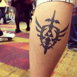 Seen at #gencon. #zelda #tattoo #gaming #indy #nerd #videogame #triforce | by mattjmendoza
