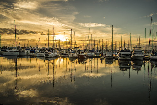 sunset sea sky water weather clouds sunrise boats day cloudy manly waterreflections sunsetsandsunrisesgold cloudsstormssunsetssunrises