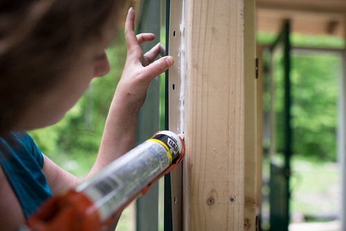 Tara Adding Caulk to Windows | by goingslowly