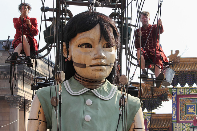Little Girl Giant leaving the Chinatown Arch, Nelson Street, Liverpool, UK