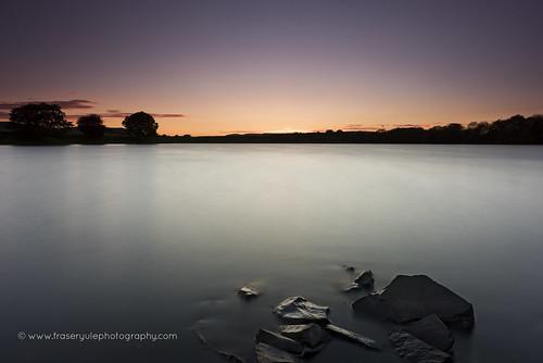 longexposure sunset sky water scotland rocks peaceful loch dumfries dumfriesgalloway lochmaben dumfriesshire millloch