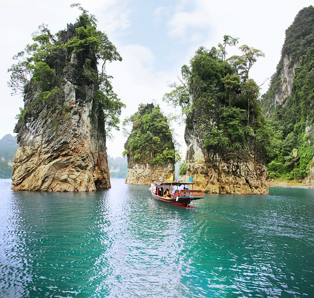 Three rock formations rise above Cheow Lan Lake