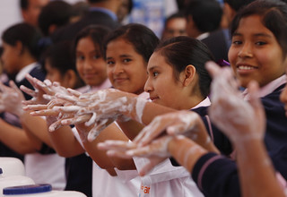 Students handwashing with soap   by World Bank Photo Collection