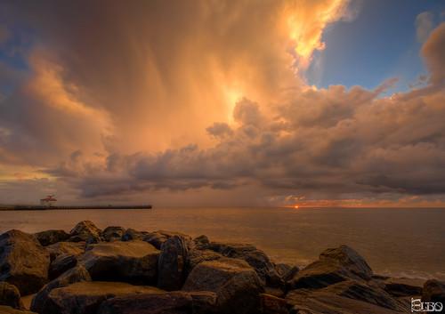 ocean sun storm beach clouds sunrise pier rocks florida cloudy jetty stormy inlet hdr boynton photomatix boyntonbeachinlet topazplugins