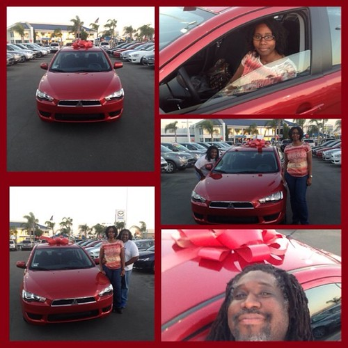Us with our newest blessing, a 2014 mitsubishi lancer! #mitsubishilancer #newcar #mitsubishi Photo