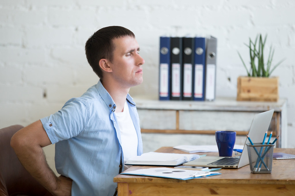 Young office man suffering from backache   Young stressed bu…   Flickr
