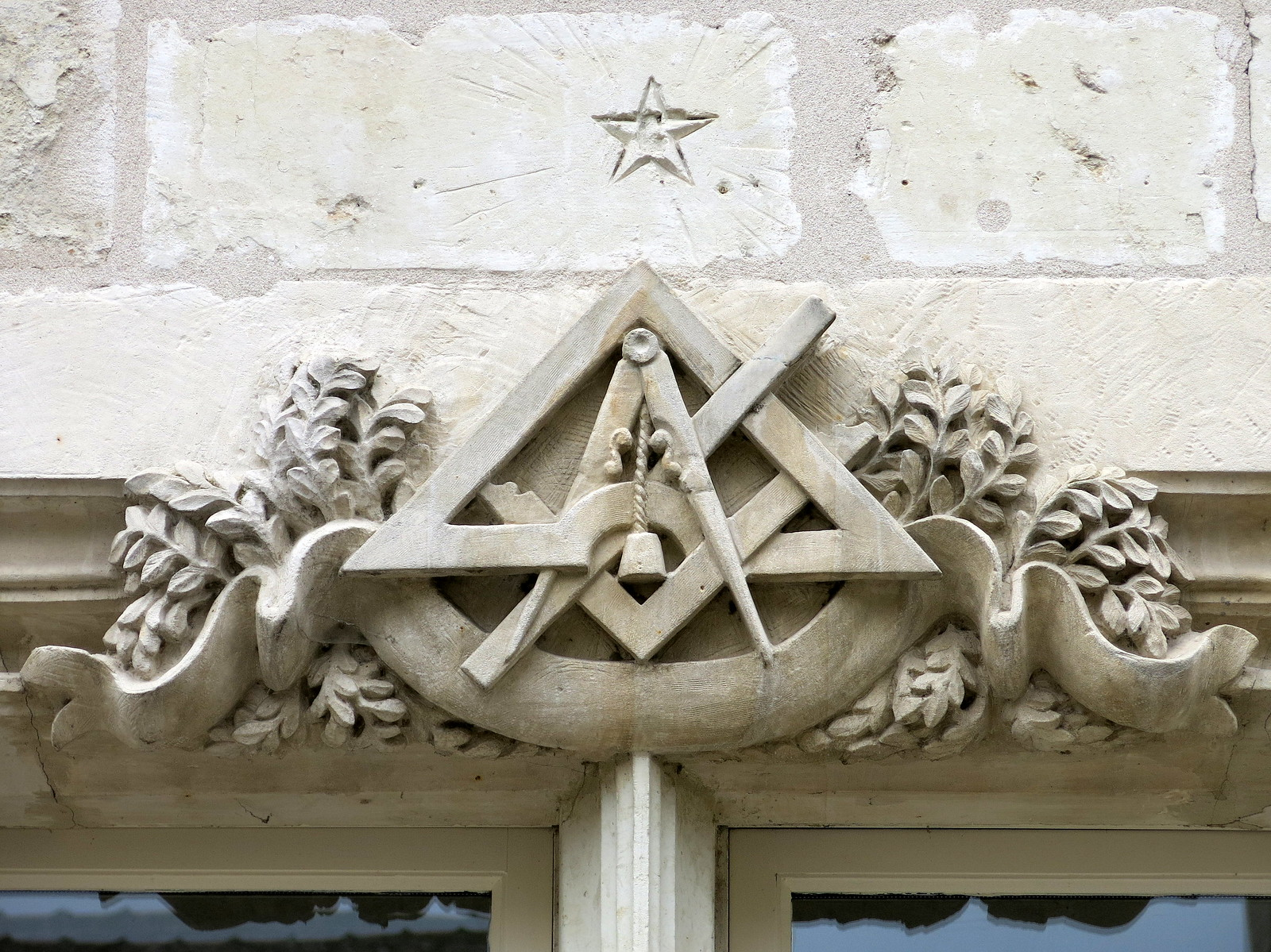 Masonic symbols carved above a doorway, Chinon, France