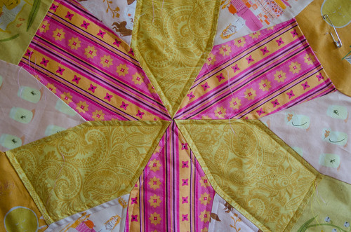 At first I thought the echo quilting would be only the start, but I'm starting to think that maybe that's all this project needs. Maybe for once I shouldn't overcomplicate things.  This quilt is based on a Hirschhorn tiling. Details of the quilt, 'Sunshine,' are at domesticat.net/quilts/sunshine