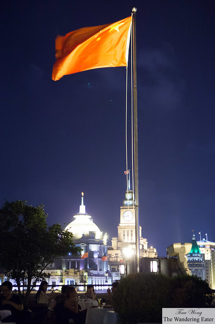 China's flag proudly showing its colors in the night