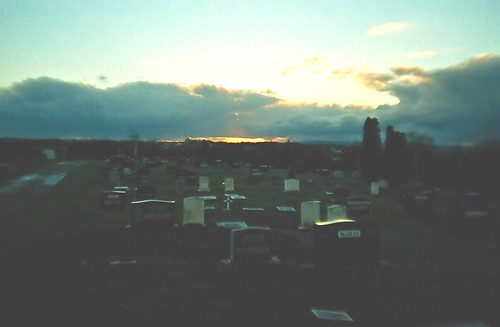 sunset sky sun cemetery clouds golden lomo lca shine dusk albaluminis over december2005 curtains glimmer bigcalm nuanc glimmerglowshimmershine endoftheday