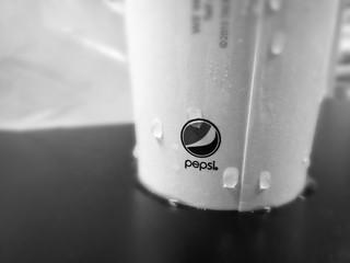 Soda bottle: Pepsi logo. Monochrome image. | by tranchristopher5