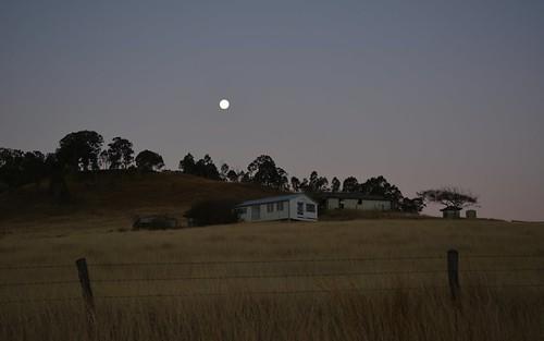 moon skyline buildings landscape evening countryside sundown dusk australia queensland hillside eveningsky australianlandscape dilapidated eveninglight fenceline fadinglight sequeensland ruralaustralia rurallandscape loganvalley runningcreek