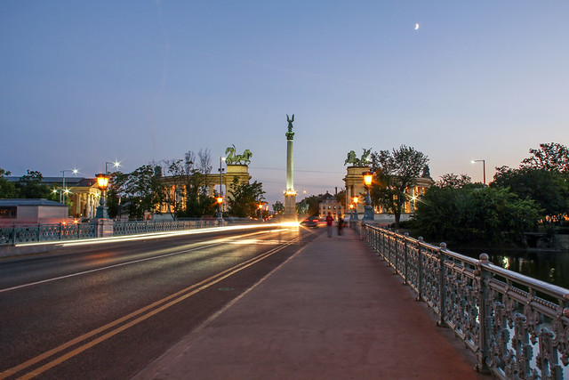 On the bridge to the Heros Square in Budapest in the sunset