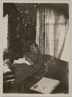 Mary Gallén sewing, wearing a Carelian dress; print 2 of the photograph. | by The Gallen-Kallela Museum