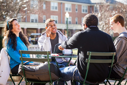 Students converse on campus