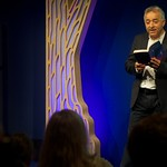 Frank Cottrell Boyce reads on stage |