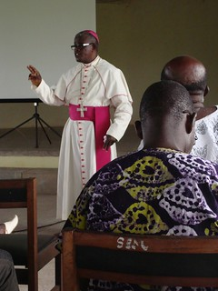 A bishop teaches an interfaith community group about the importance of sustainable fishing, Takoradi, Ghana