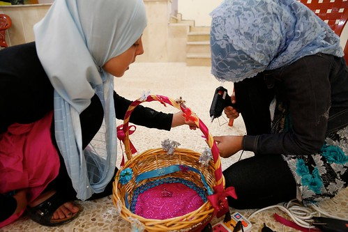Syrian and Lebanese girls work together to decorate a basket, as part of a psycho-social and gender-based violence support project in southern Lebanon | by DFID - UK Department for International Development