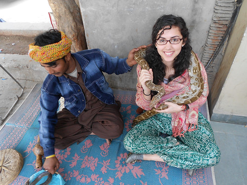 A student poses with a snake charmer