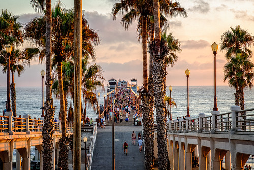 ocean california trees sunset people water clouds pier crowd palm oceanside