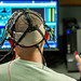 A test subject uses the Multi-Attribute Task Battery to perform a multitasking cognitive test while electrodes administer directed electrical brain stimulation in the Non-Invasive Brain Stimulation (NIBS) lab at the Air Force Research Laboratory, Wright Patterson Air Force Base, Ohio, Jul 19, 2016. Researchers working in the NIBS lab, led by Dr. Richard A. McKinley, Ph.D., are exploring how directed electrical stimulation to the human brain affects cognition, fatigue, mood and other areas with the end goal of improving warfighter awareness, memory and focus. (U.S. Air Force photo by J.M. Eddins Jr.)