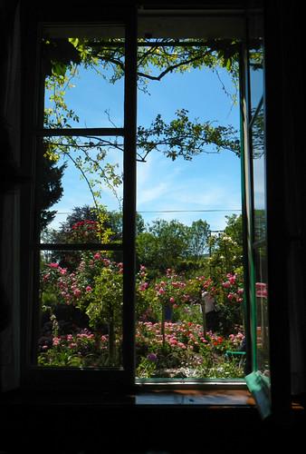 A window in Monet's house overlooks his exuberant garden