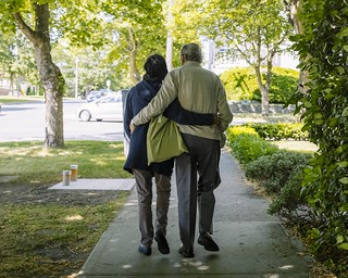 Elderly couple walk together | by hugochisholm