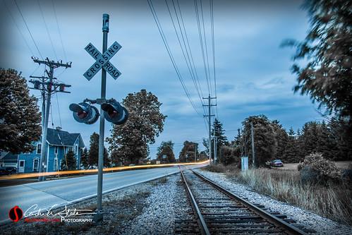 road longexposure railroad morning blue orange wisconsin clouds sunrise landscape am crossing unitedstates zoom gray waukesha wi zip lighttrail sunsetdr
