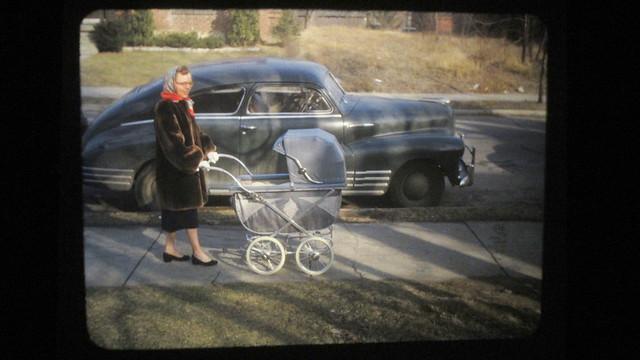 IMG_1115 margaret pushing baby buggy sidewalk car-001