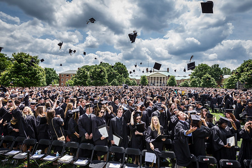 Students toss their mortarboards during Commencement ceremony