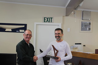 Corrado Corda (right) , winner of the Winter Handicap Series (B division) being presented Smith Trophy Intermediate Trophy by Will Perry | by PLSC (Panmure Lagoon Sailing Club)