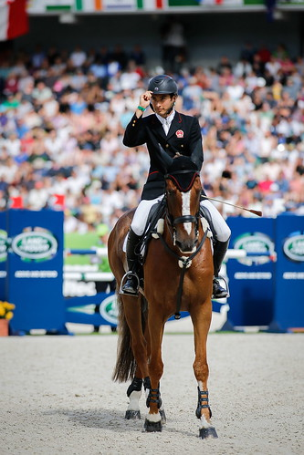Alex and Harbour Pilot C salute the judges at the World Equestrian Games 2014 Photo Xia Yuanpu | by noblehua1