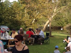 Club members and families enjoying food and company at the social.