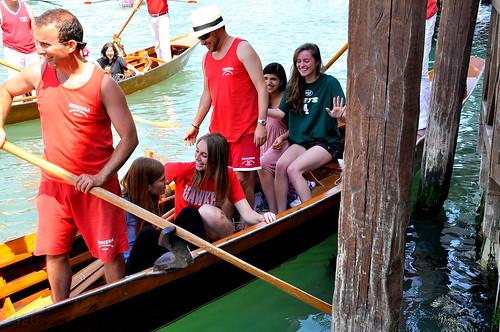 Students board a gondola in Venice, Italy